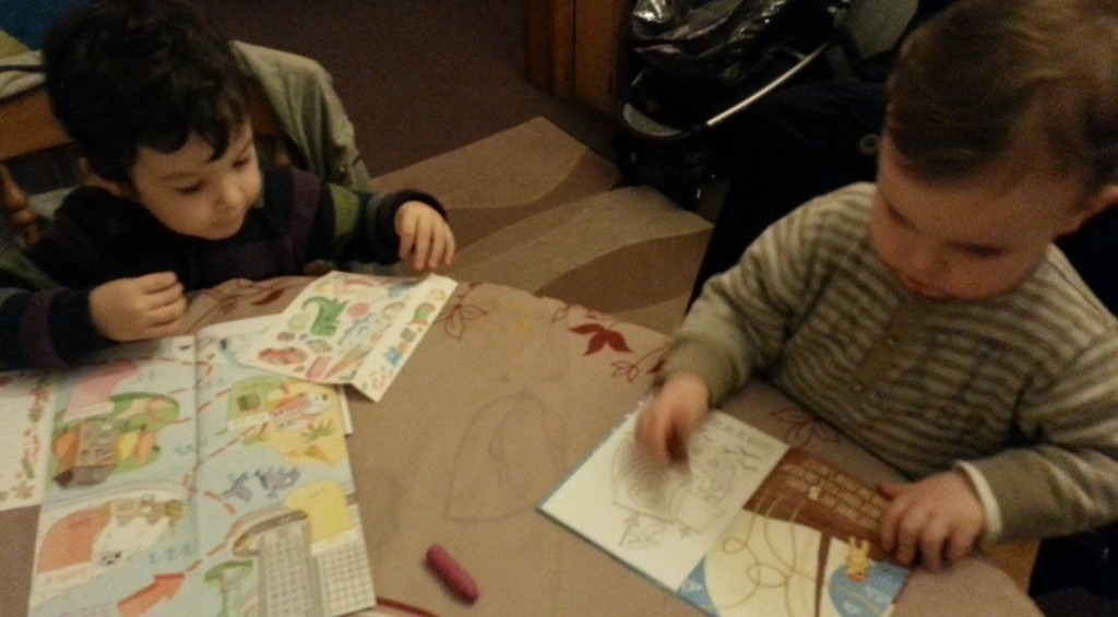 Image of two little boys colouring in cards.