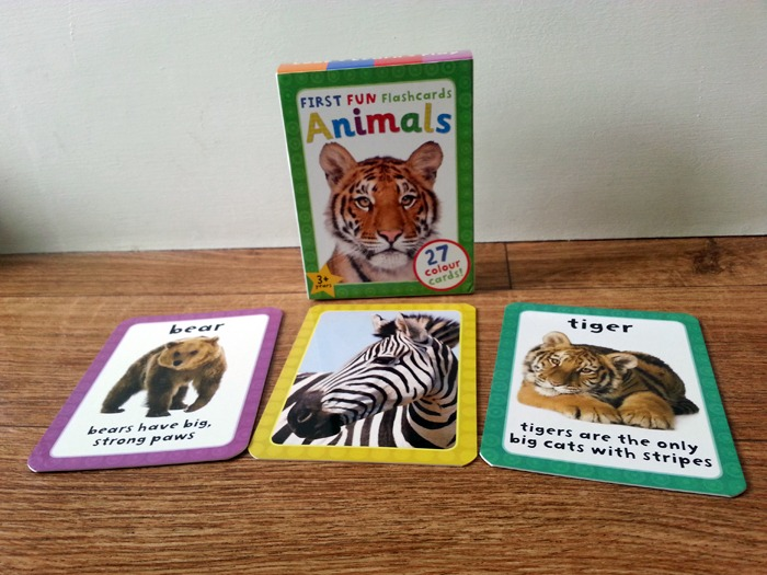 A box of flashcards with three cards with photos of animals in front of it
