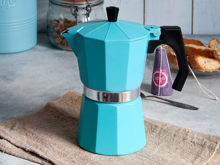 An espresso pot on a kitchen surface.