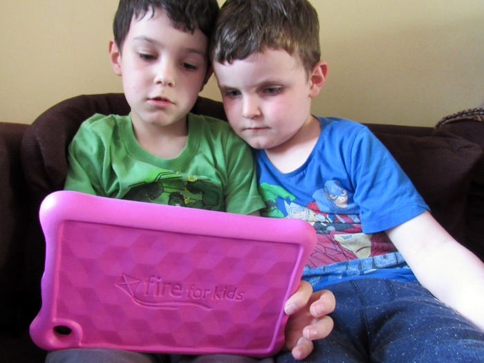 Two boys using an Amazon Fire Kids Edition tablet.