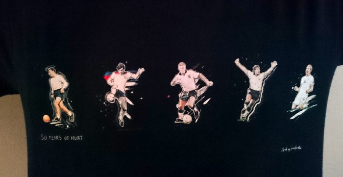 Close-up of a T-shirt featuring players from Spurs and England.