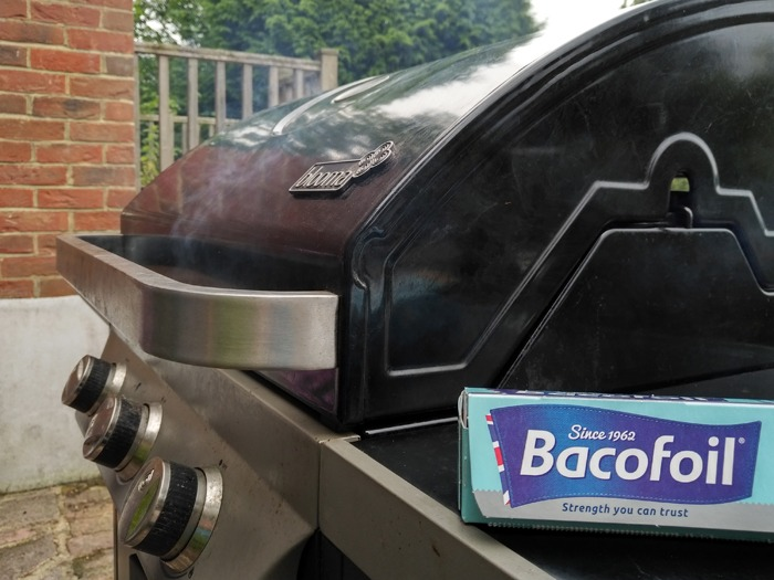 A barbecue with a pack of Bacofoil.