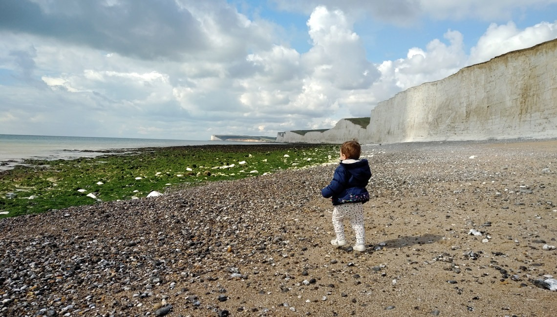 A toddler on the beach at Birling Gap.