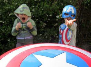 Two boys dressed as Hulk and Captain America with props from the Disney Store.