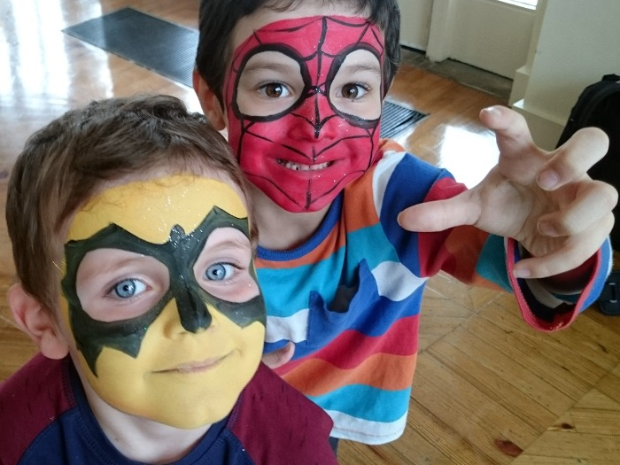 Two young boys wearing facepaint.