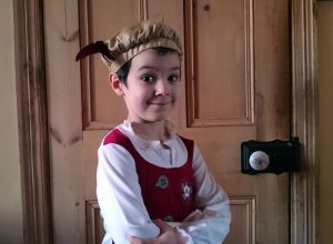 A young boy wearing a Tudor costume.