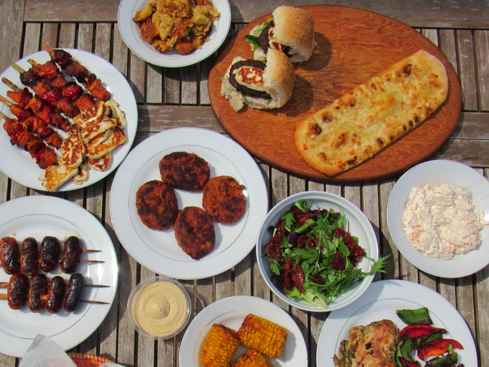 A selection of barbecue food on a table.