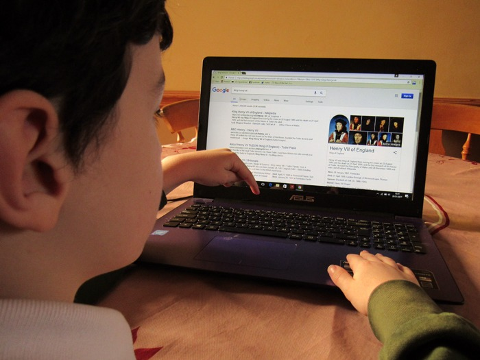 A child using a laptop computer.