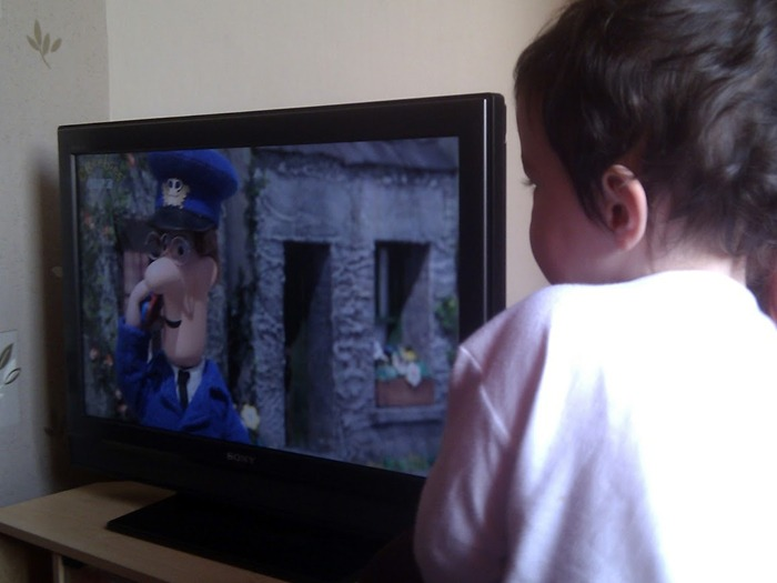 A young boy watching Postman Pat. And probably not wondering what happened to Miss Hubbard.