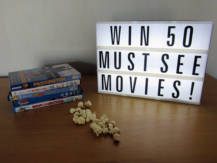 A lightbox with some DVDs and popcorn.