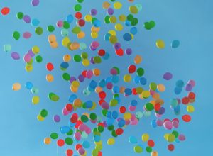 Numerous balloons in the sky. Symbolic of being partied out. Sort of.