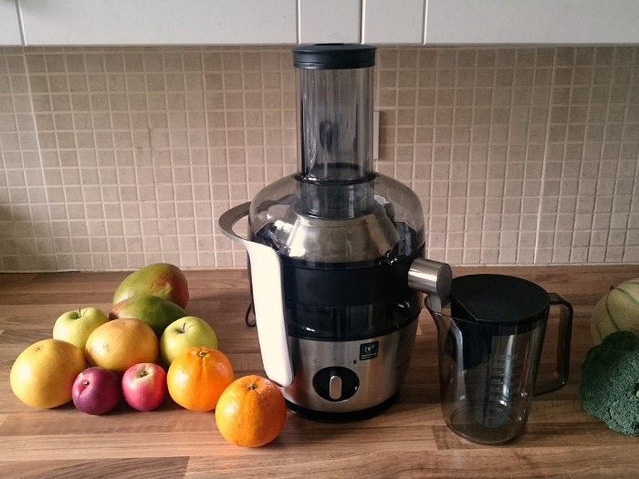 The Philips Centrifugal juicer with a selection of fruit and vegetables.