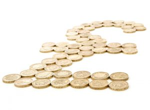 Several pound coins put together to create a pound sign.