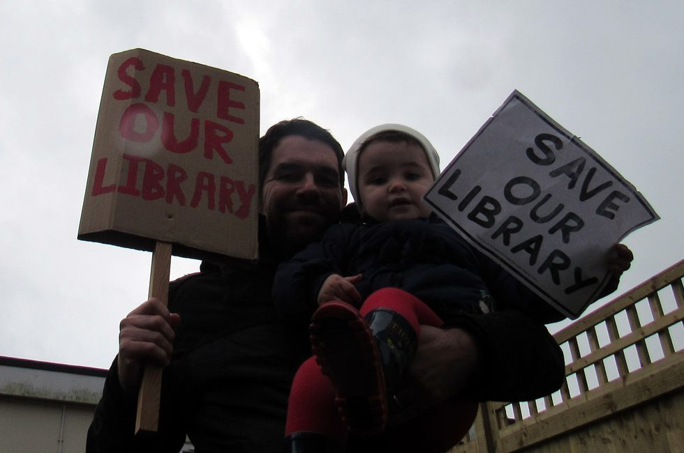 A father and daughter at a protest march.