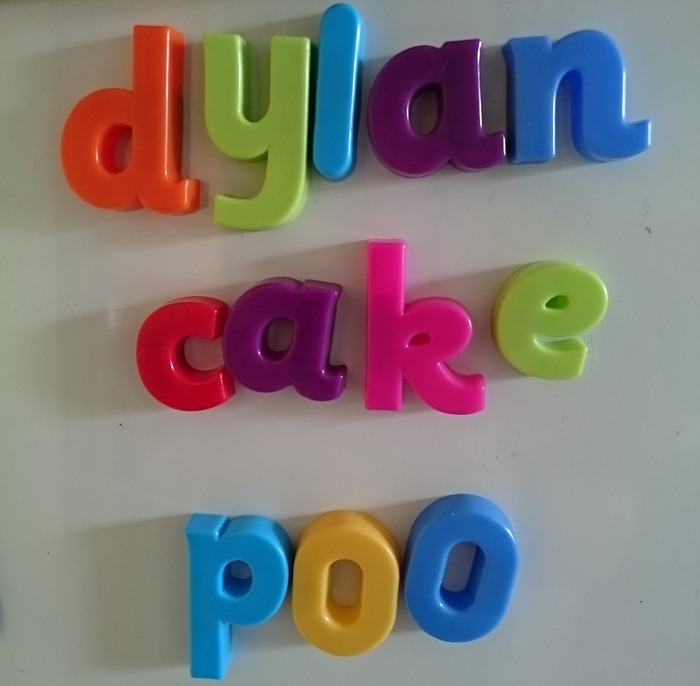 "Some magnetic letters spelling out the words: ""Dylan"", ""cake"" and ""poo""."