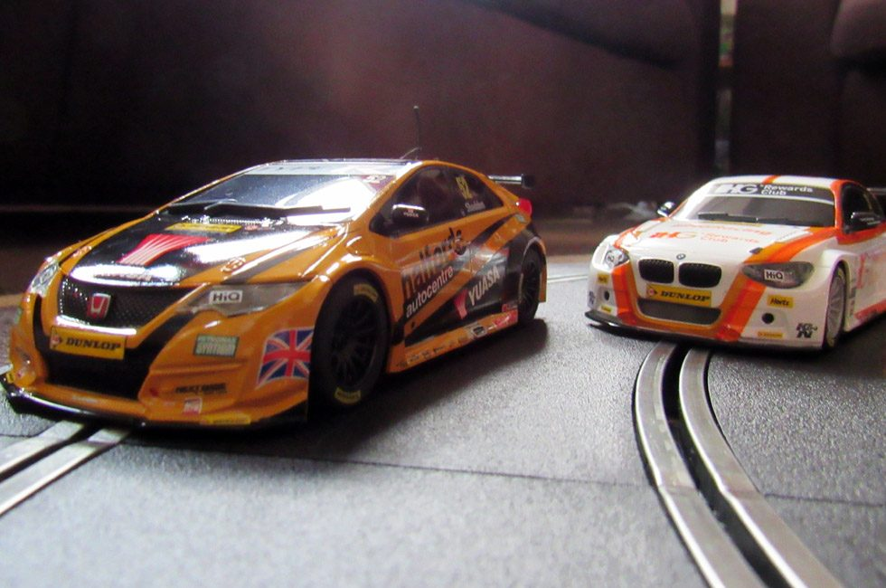 Two cars from the Scalextric Touring Car Battle set.