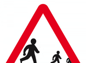 A mocked-up road sign showing two children running away from their dad.