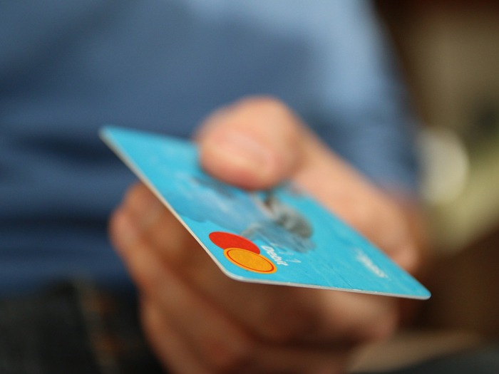 A close-up of a credit card in someone's hand.