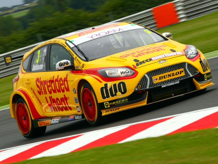 Mat Jackson's Team Shredded Wheat car zooming along the Snetterton track.
