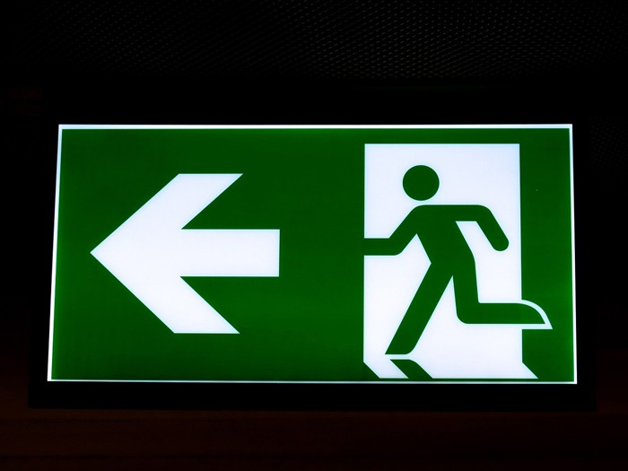 An exit sign being used to show how I escaped stress.