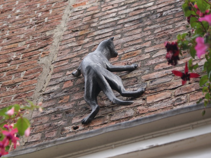 A cat statue on a wall.