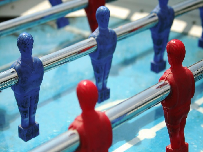 A game of table football about to kick off.