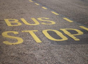 A bus stop. You just need to imagine them coming in two by two.