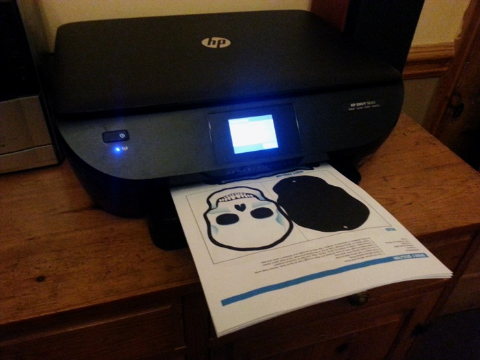 A printer printing out some Halloween decorations.