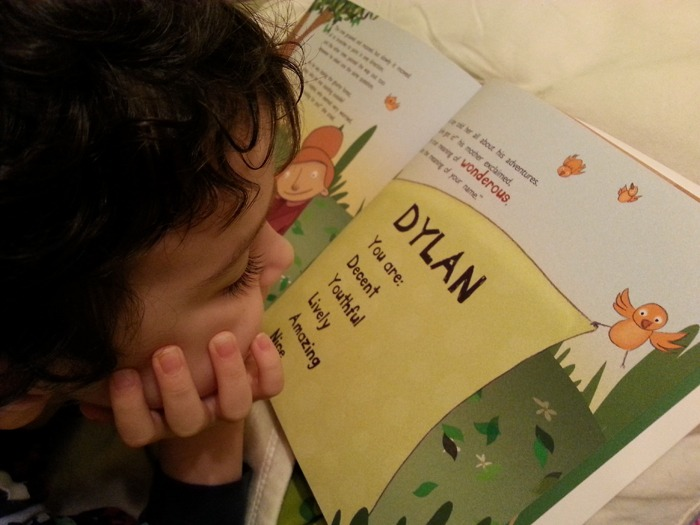 A close-up of a little boy reading his book.