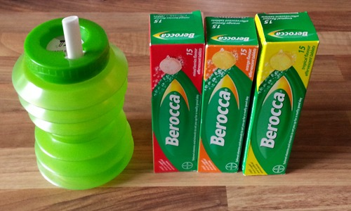 Three packs of Berocca and a fold-up cup.