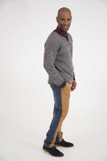 A man wearing a pair of trousers that are half jeans and half chinos.