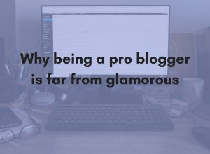 "A cluttered desk with the words ""Why being a pro blogger is far from glamorous"" superimposed."