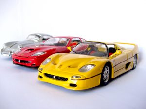 Three expensive-looking toy cars.