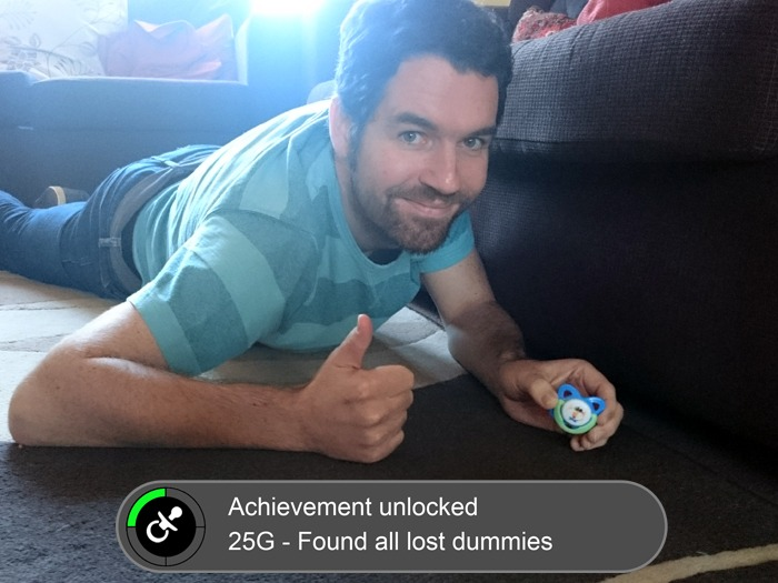 A man finding a dummy under the sofa with a video game achievement graphic superimposed.