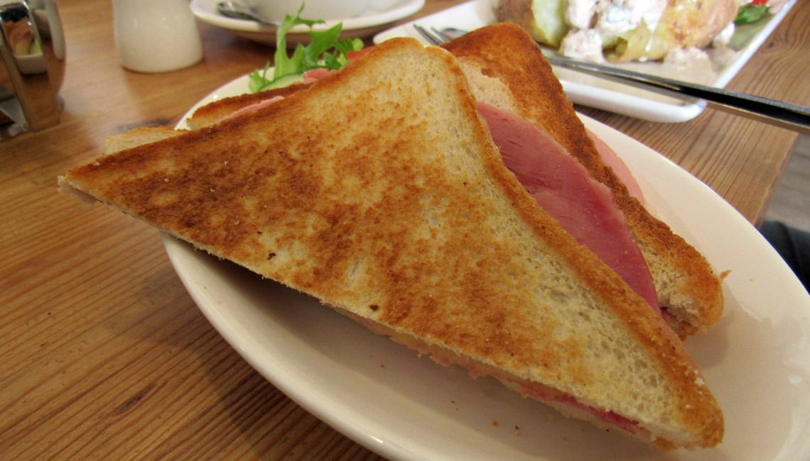A toastie on a plate.