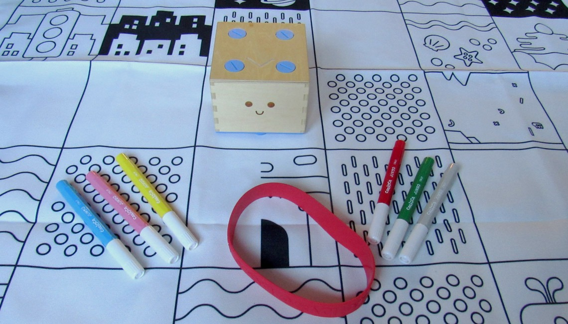 The contents of the Cubetto Colouring Pack.