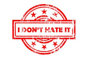 """A rubber stamp design with the words """"I don't hate it"""" in the middle."""