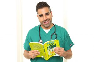 Dr Ranj posing with a copy of How to Grow Up (and Feel Amazing!)