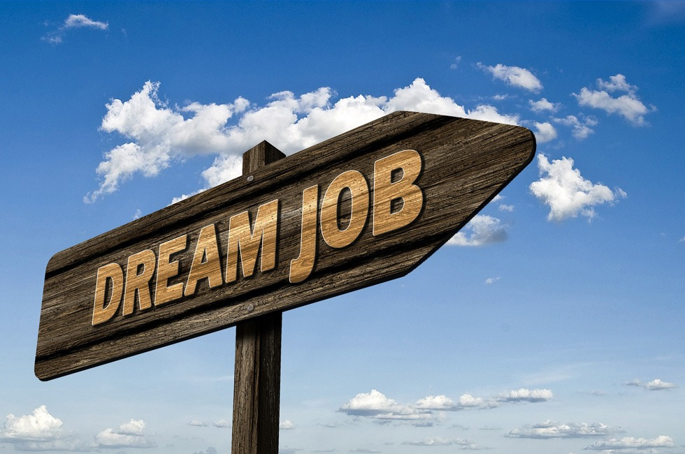 "A sign with the words ""dream job"" on it."