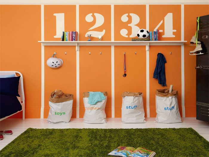 A child's bedroom painted in a sports theme.