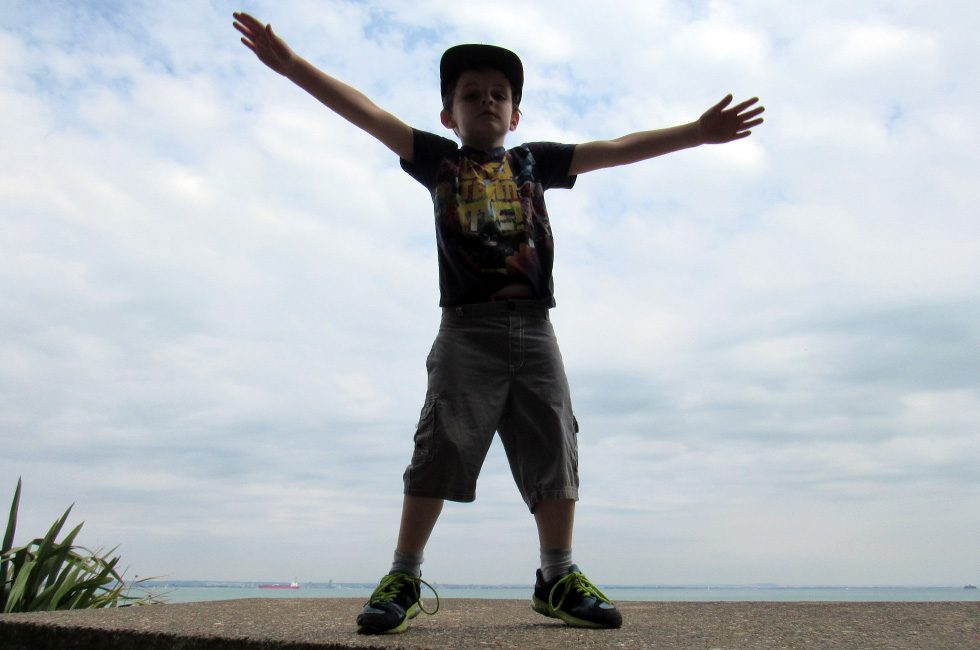A child standing in a celebratory pose.