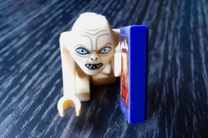 A toy of Gollum from Lord of the Rings holding a toy smartphone.