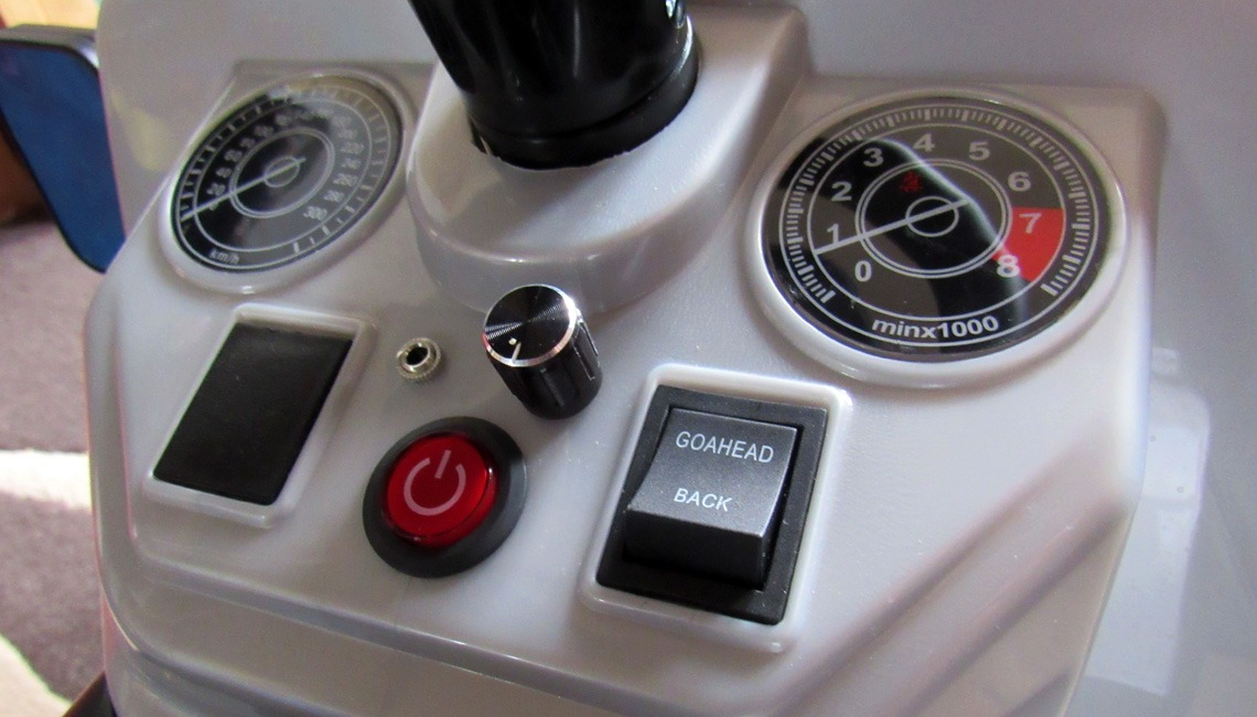 The dashboard of a Land Rover Defender Ride On.