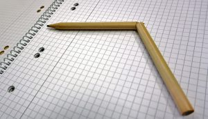A broken pencil on an exercise book. How much homework is too much?