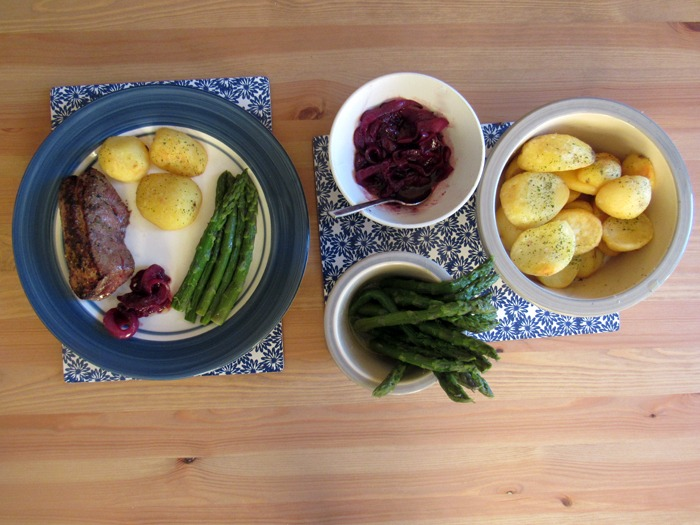 A French Father's Day feast of pan fried duck breast with cherry sauce, potatoes and asparagus.