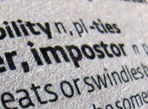 A close-up of a dictionary showing the word impostor.