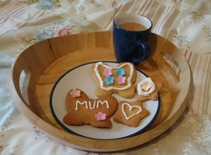 A tray of tea and biscuits.