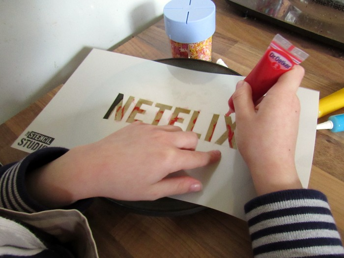 A stencil designed for adding the Netflix logo to pancakes.