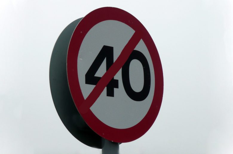A 40 sign with a diagonal red line across the number