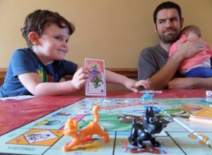 A father and his children playing a board game.